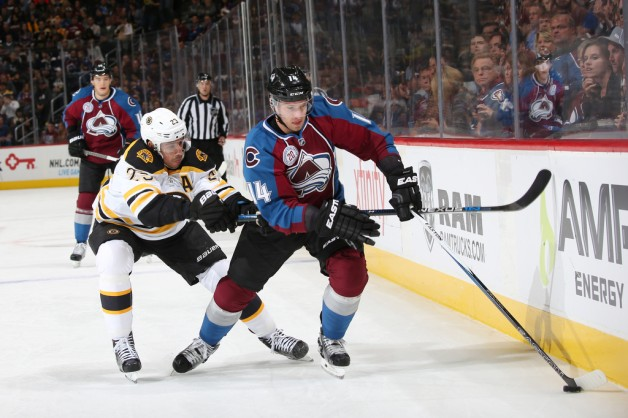 DENVER, CO - OCTOBER 14: Blake Comeau #14 of the Colorado Avalanche skates with the puck as Chris Kelly #23 of the Boston Bruins defends at the Pepsi Center on October 14, 2015 in Denver, Colorado.  (Photo by Michael Martin/NHLI via Getty Images)