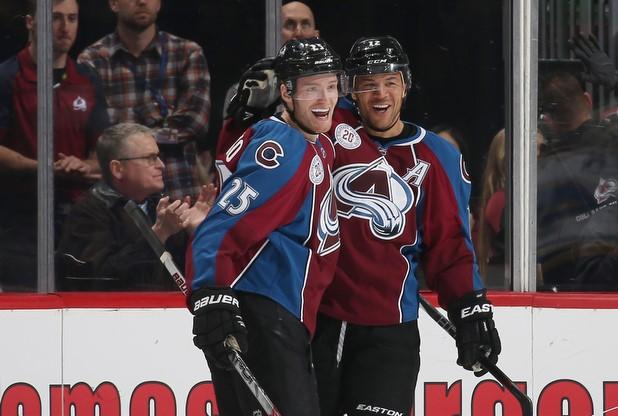 DENVER, CO - JANUARY 6: Jarome Iginla #12 and Andreas Martinsen #27 of the Colorado Avalanche celebrate with Mikhail Grigorenko #25 after his goal against the St. Louis Blues at the Pepsi Center on January 6, 2016 in Denver, Colorado. (Photo by Michael Martin/NHLI via Getty Images)